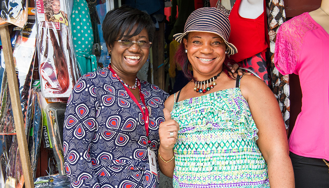 Marie Marcelle Gerard Saint-Gilles, the CEO of FINCA Haiti, with a client